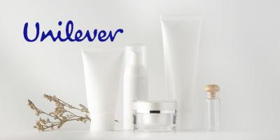 Image contains photograph of brandless beauty products and Unilever's logo above them.