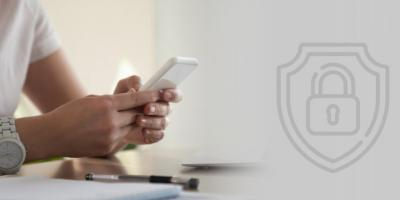 Image contains photograph of a person operating a smartphone and also contains an icon with a closed lock representing Data Privacy.
